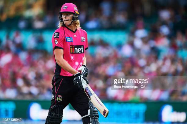Jack Edwards of the Sixers walks from the field after being dismissed by Peter Handscomb of the Stars during the Big Bash League match between the...
