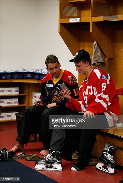 Jack Eichel and Dylan Strome sit in the locker room before participating in the Top Prospects Clinic as part of the 2015 NHL Entry Draft Weekend at...