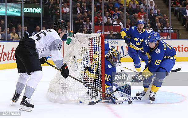 Jack Eichel of Team North America tries to get the puck past Henrik Lundqvist with Nicklas Backstrom of Team Sweden in front during the World Cup of...