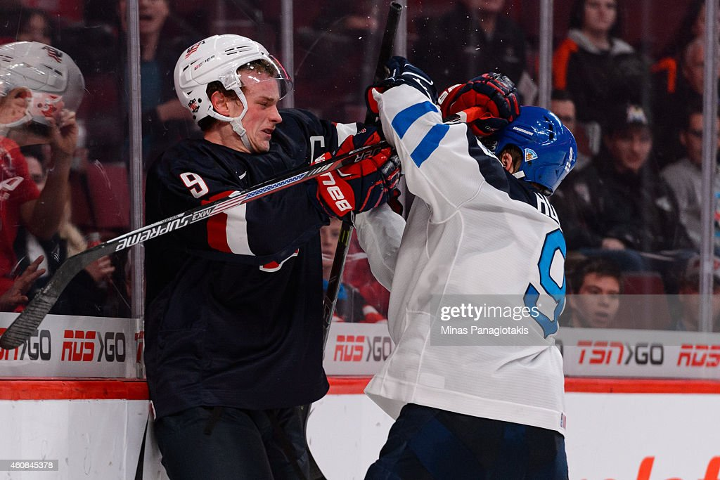 Jack Eichel #9 of Team United States and Julius Honka #9 of Team Finland push one another during the 2015 IIHF World Junior Hockey Championship game at the Bell Centre on December 26, 2014 in Montreal, Quebec, Canada. Team United States defeated Team Finland 2-1 in a shootout.