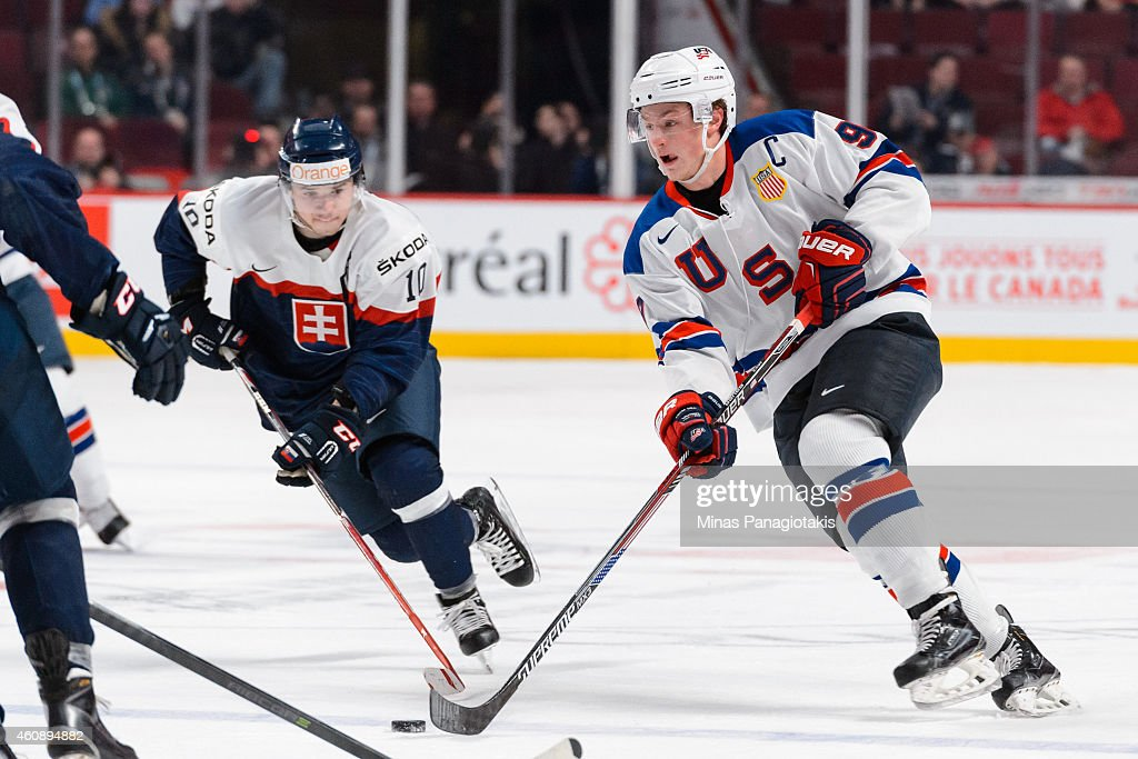 Jack Eichel #9 of Team United States carries the puck during the 2015 IIHF World Junior Hockey Championship game against Team Slovakia at the Bell Centre on December 29, 2014 in Montreal, Quebec, Canada. Team United States defeated Team Slovakia 3-0.
