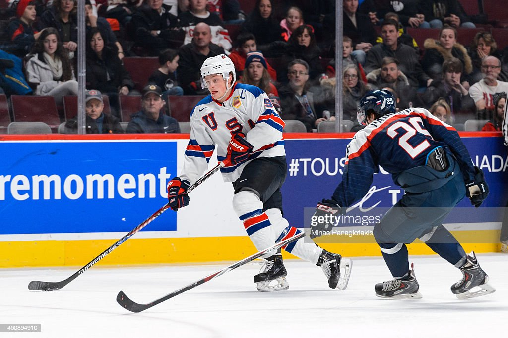 Jack Eichel #9 of Team United States carries the puck with Matej Paulovic #29 of Team Slovakia following during the 2015 IIHF World Junior Hockey Championship game at the Bell Centre on December 29, 2014 in Montreal, Quebec, Canada. Team United States defeated Team Slovakia 3-0.