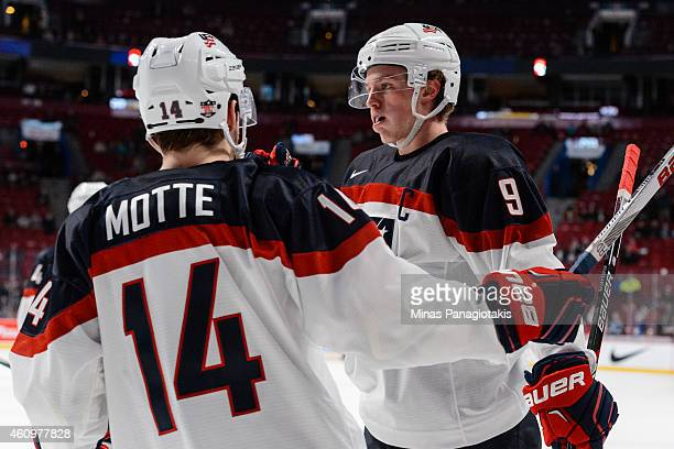Jack Eichel of Team United States celebrates his goal with teammate Tyler Motte during the 2015 IIHF World Junior Hockey Championship game against...