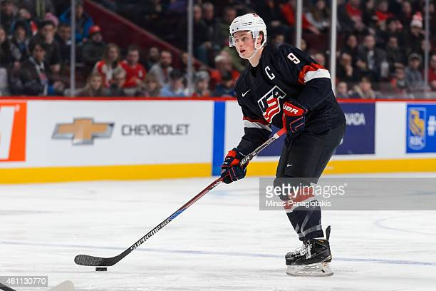 Jack Eichel of Team United States looks to play the puck in a quarterfinal round during the 2015 IIHF World Junior Hockey Championships against Team...