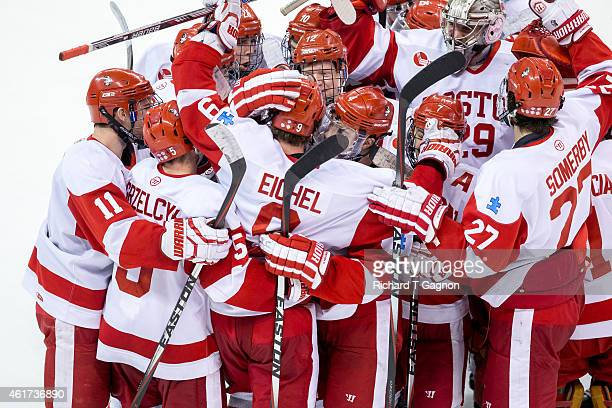 Jack Eichel of the Boston University Terriers celebrates his overtime winning goal with his teammate during NCAA hockey against the Massachusetts...