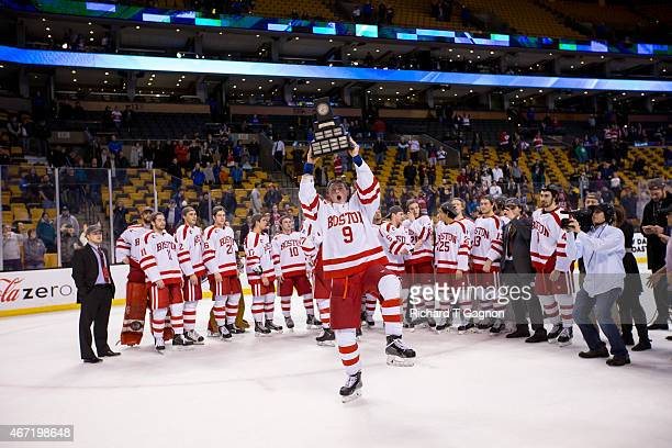 Jack Eichel of the Boston University Terriers raises The Lou Lamoriello Trophy above his head after the Terriers won the Hockey East Championship...