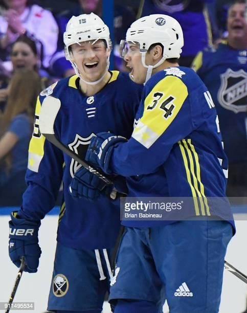 Jack Eichel of the Buffalo Sabres and Auston Matthews of the Toronto Maple Leafs celebrate during the 2018 Honda NHL All-Star Game between the...