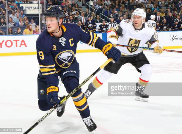 Jack Eichel of the Buffalo Sabres and Paul Stastny of the Vegas Golden Knights follow the play during an NHL game on October 8 2018 at KeyBank Center...