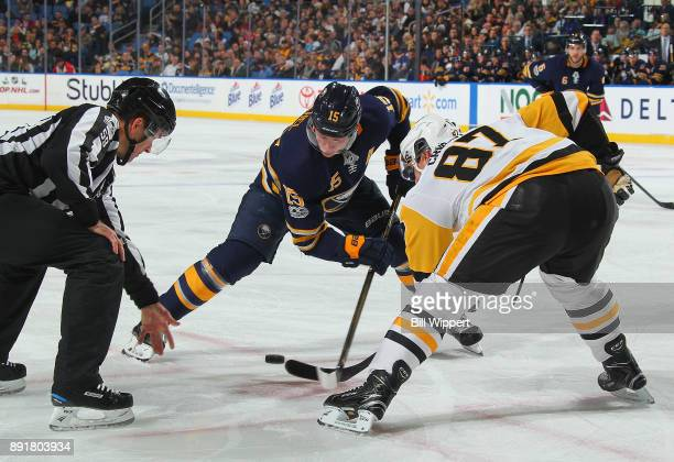 Jack Eichel of the Buffalo Sabres and Sidney Crosby of the Pittsburgh Penguins take a faceoff during an NHL game on December 1 2017 at KeyBank Center...