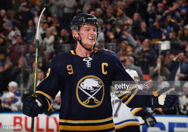 Jack Eichel of the Buffalo Sabres celebrates a goal scored by Zemgus Girgensons during an NHL game against the St Louis Blues on December 10 2019 at...