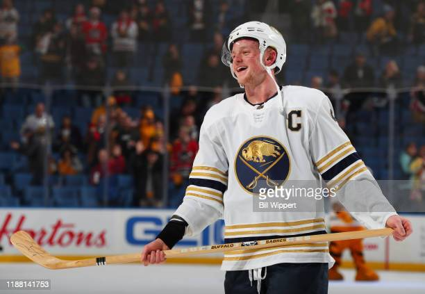 Jack Eichel of the Buffalo Sabres celebrates a victory over the Nashville Predators after an NHL game on December 12 2019 at KeyBank Center in...