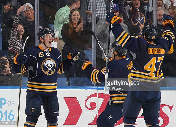 Jack Eichel of the Buffalo Sabres celebrates after scoring the gamewinning goal with one second remaining in overtime against the Carolina Hurricanes...
