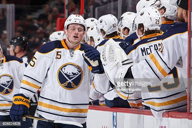 Jack Eichel of the Buffalo Sabres celebrates his first period goal against the Ottawa Senators with teammates at the players bench at Canadian Tire...
