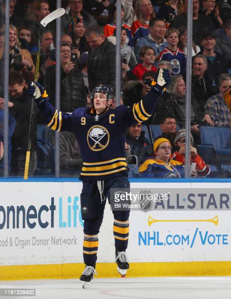 Jack Eichel of the Buffalo Sabres celebrates his gamewinning goal from a penalty shot in overtime during an NHL game against the Edmonton Oilers on...