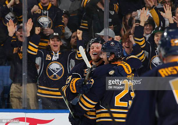 Jack Eichel of the Buffalo Sabres celebrates his second period goal against the Dallas Stars with teammate Sam Reinhart during an NHL game at the...