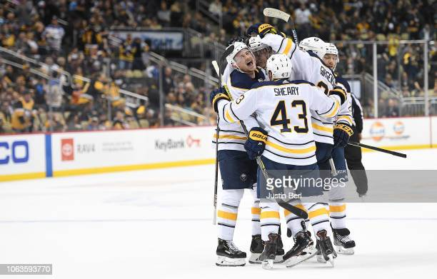 Jack Eichel of the Buffalo Sabres celebrates with teammates after scoring the game winning goal during overtime to give the Buffalo Sabres a 54 win...