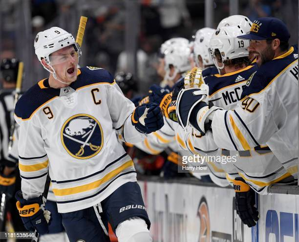 Jack Eichel of the Buffalo Sabres celebrateshis goal with Carter Hutton to take a 10 lead over the Anaheim Ducks during the first period at Honda...