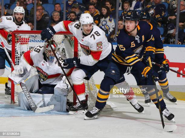 Jack Eichel of the Buffalo Sabres controls the puck against Maxim Mamin and Harri Sateri of the Florida Panthers during an NHL game on February 1...