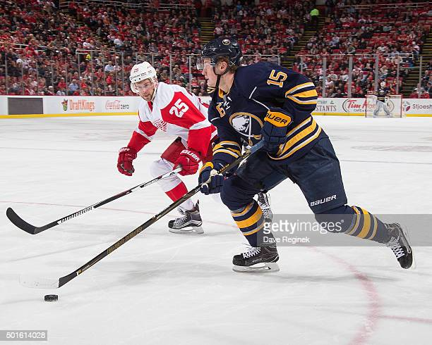 Jack Eichel of the Buffalo Sabres controls the puck next to Mike Green of the Detroit Red Wings during an NHL game at Joe Louis Arena on December 14,...