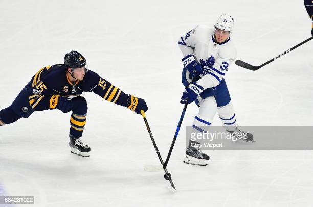 Jack Eichel of the Buffalo Sabres defends against Auston Matthews of the Toronto Maple Leafs during an NHL game at the KeyBank Center on April 3 2017...