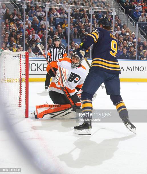 Jack Eichel of the Buffalo Sabres deflects a shot from Lawrence Pilut for a goal against Anthony Stolarz of the Philadelphia Flyers during an NHL...