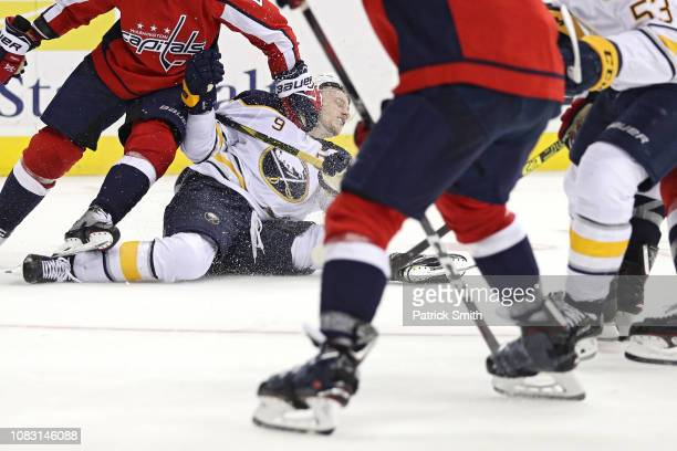 Jack Eichel of the Buffalo Sabres is checked by Michal Kempny of the Washington Capitals during the third period at Capital One Arena on December 15...