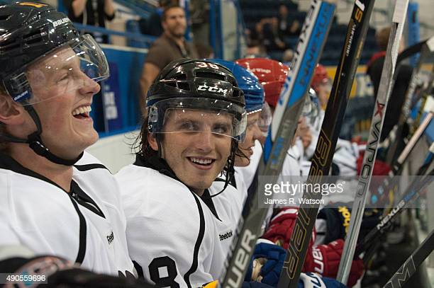 Jack Eichel of the Buffalo Sabres laughs with Ryan Hartman of the Chicago Blackhawks during a pickup game at the 2015 NHLPA Rookie Showcase at...