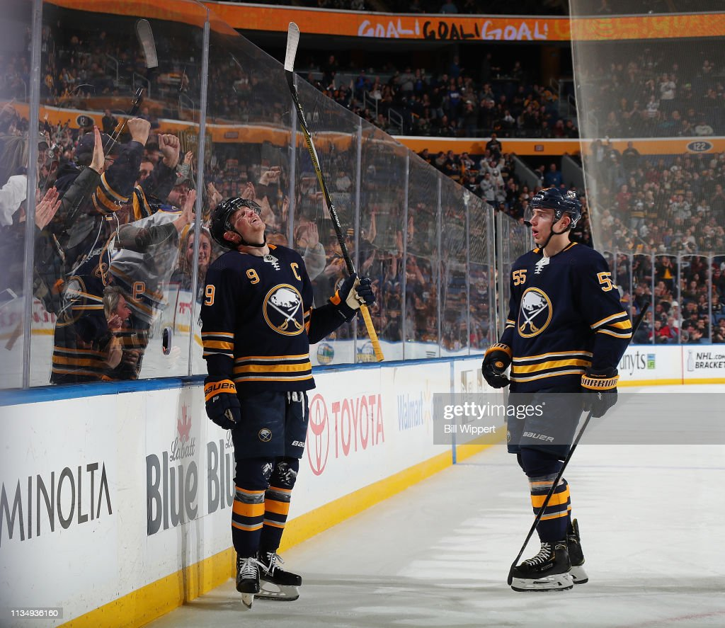 premium selection 27697 704c4 Jack Eichel of the Buffalo Sabres reacts alongside Rasmus ...