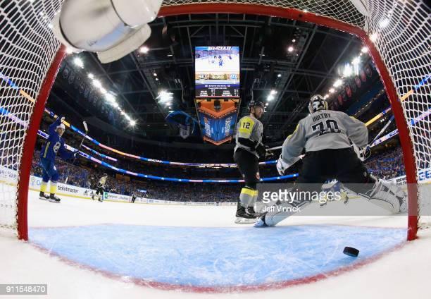 Jack Eichel of the Buffalo Sabres scores on goaltender Braden Holtby of the Washington Capitals as Auston Matthews of the Toronto Maple Leafs reacts...