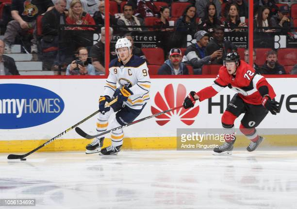 Jack Eichel of the Buffalo Sabres stickhandles the puck against Thomas Chabot of the Ottawa Senators at Canadian Tire Centre on November 1 2018 in...