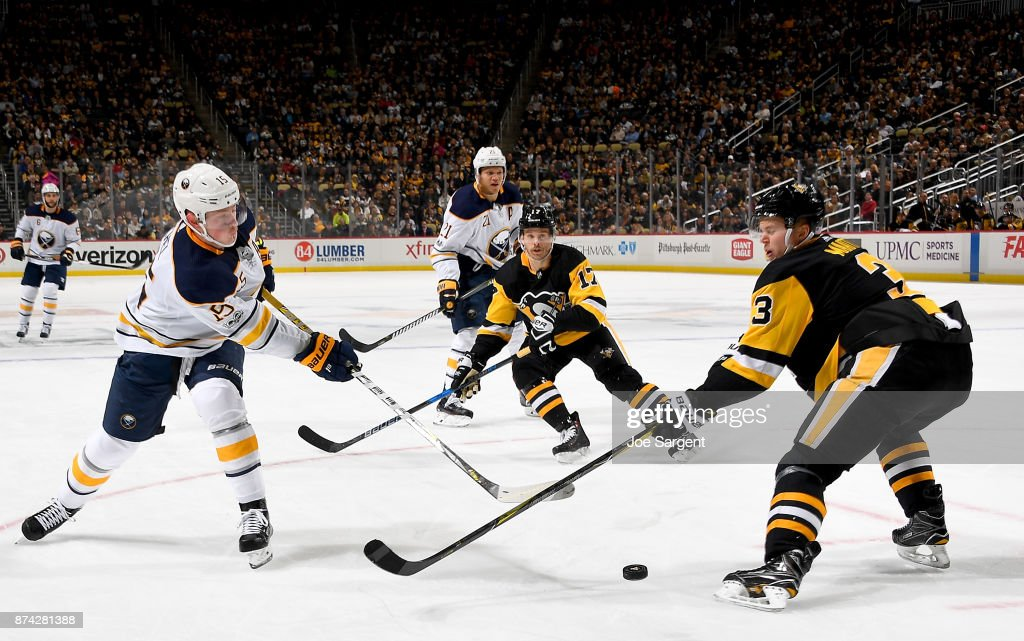 Jack Eichel #15 of the Buffalo Sabres takes a shot against Olli Maatta #3 of the Pittsburgh Penguins at PPG Paints Arena on November 14, 2017 in Pittsburgh, Pennsylvania.
