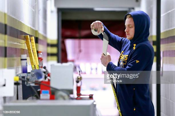 Jack Eichel of the Buffalo Sabres tapes his game stick before their NHL game against the Vancouver Canucks at Rogers Arena January 18, 2019 in...