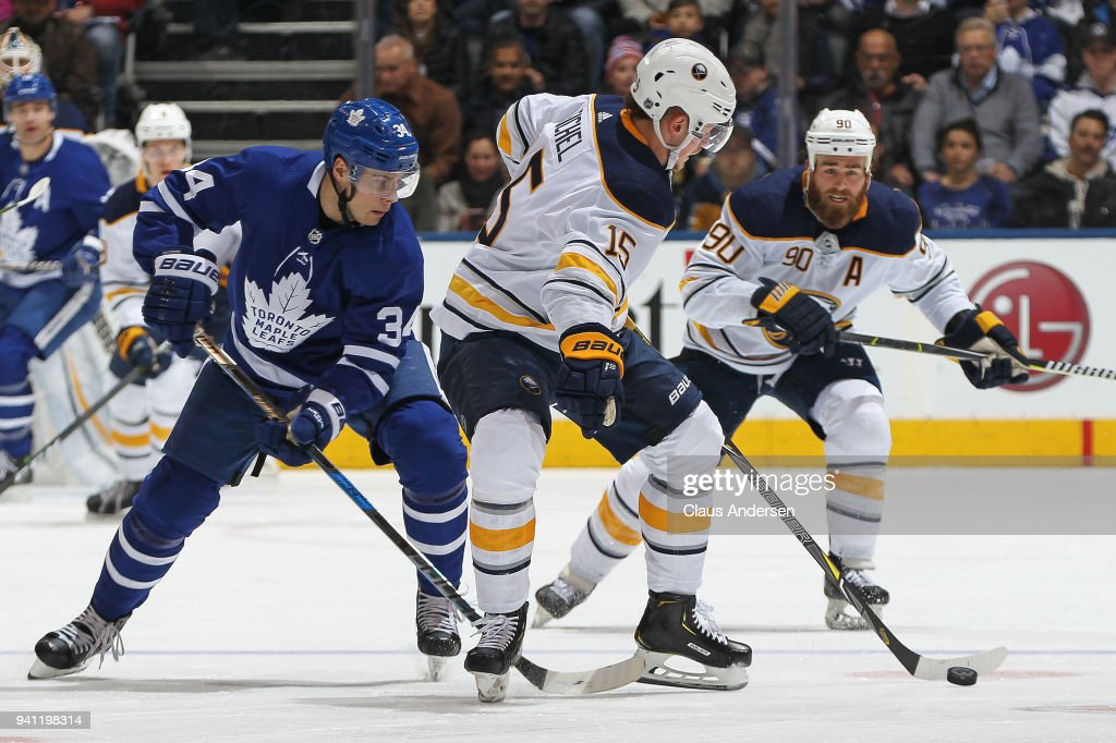Jack Eichel #15 of the Buffalo Sabres tries to keep the puck away from Auston Matthews #34 of the Toronto Maple Leafs during an NHL game at the Air Canada Centre on April 2, 2018 in Toronto, Ontario, Canada. The Maple Leafs defeated the Sabres 5-2.