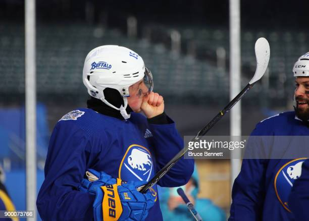 Jack Eichel of the Buffalo Sabres tries to stay warm during practice at Citi Field on December 31 2017 in the Flushing neighborhood of the Queens...
