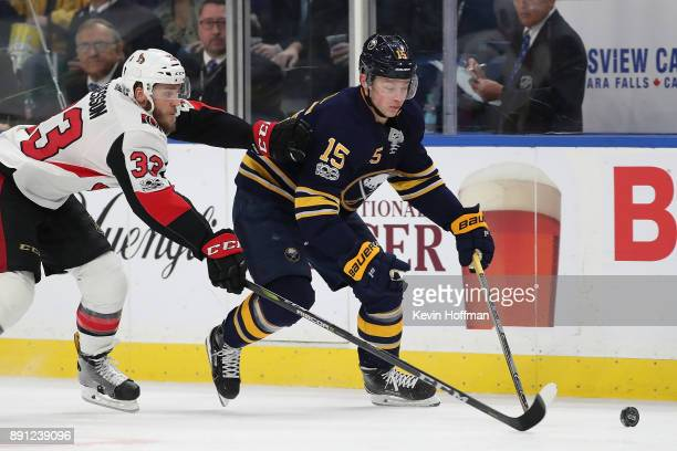 Jack Eichel of the Buffalo Sabres with the puck as Fredrik Claesson of the Ottawa Senators pursues during the second period at the KeyBank Center on...