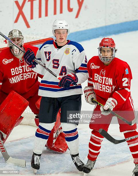 Jack Eichel of the USA National Junior Team battles Brandon Fortunato and Matt O'Connor both of the Boston University Terriers during NCAA exhibition...