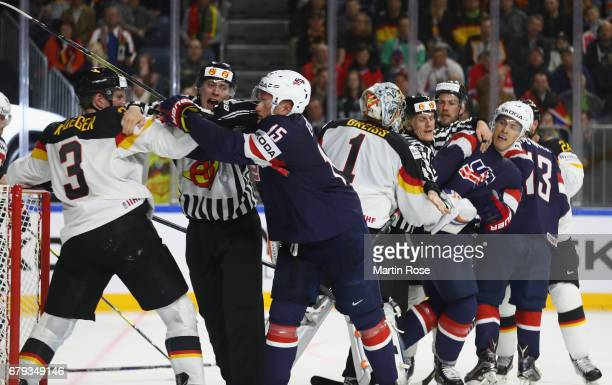 Jack Eichel of USA fights with Justin Krueger of Germany during the 2017 IIHF Ice Hockey World Championship game between USA and Germany at Lanxess...