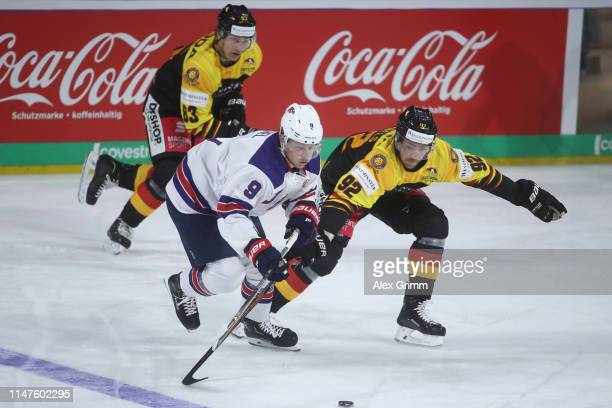 Jack Eichel of USA is challenged by Marcel Noebels of Germany during the international friendly game between Germany and USA ahead of the 2019 IIHF...