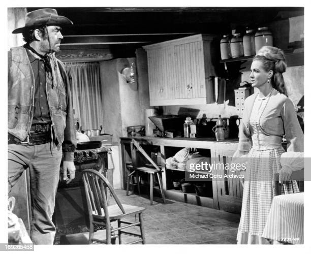 Jack Elam looking at Angie Dickinson in the kitchen in a scene from the film 'The Last Challenge' 1967