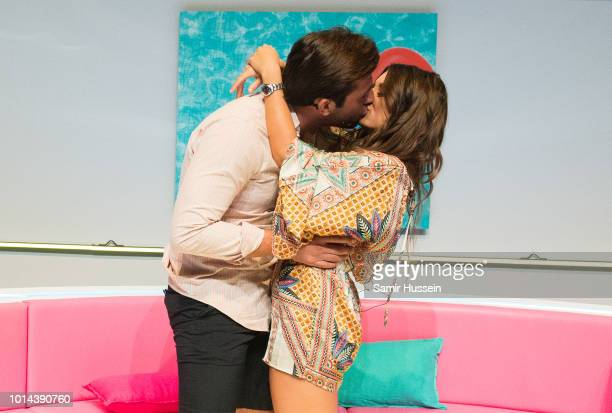 Jack Fincham and Dani Dyer kiss during the 'Love Island Live' photocall at ICC Auditorium on August 10 2018 in London England