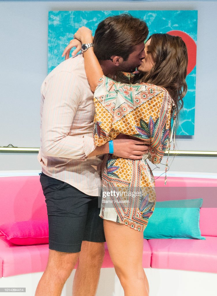 Jack Fincham and Dani Dyer kiss during the 'Love Island Live' photocall at ICC Auditorium on August 10, 2018 in London, England.