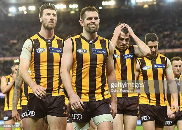 Jack Fitzpatrick, Luke Hodge and Isaac Smith of the Hawks look dejected after losing the second AFL semi final between Hawthorn Hawks and Western...