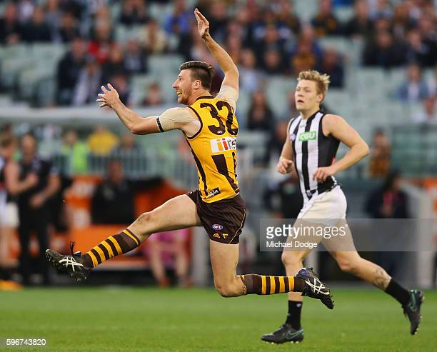 Jack Fitzpatrick of the Hawks kicks the ball for a goal in the dying stages during the round 23 AFL match between the Hawthorn Hawks and the...