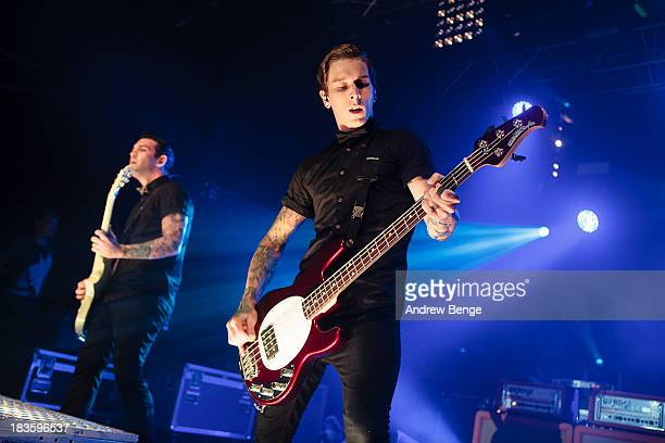Jack Fowler and Justin Hills of Sleeping With Sirens perform on stage at Manchester Academy on October 7 2013 in Manchester England