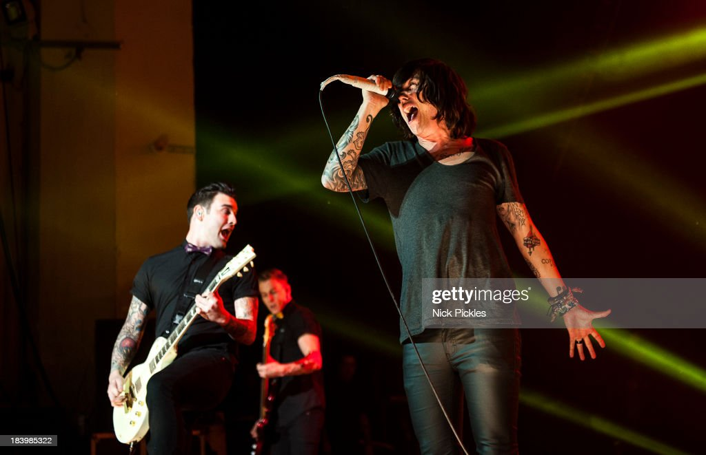 Jack Fowler and Kellin Quinn of Sleeping With Sirens perform on stage at Brixton Academy on October 10, 2013 in London, England.