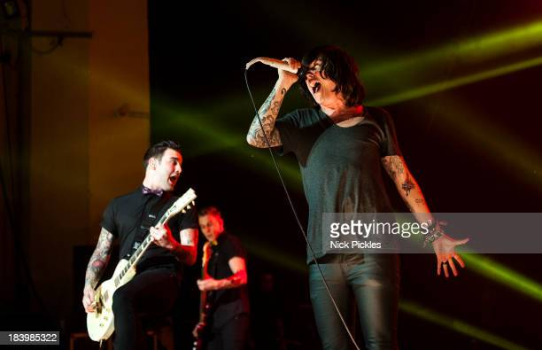 Jack Fowler and Kellin Quinn of Sleeping With Sirens perform on stage at Brixton Academy on October 10 2013 in London England