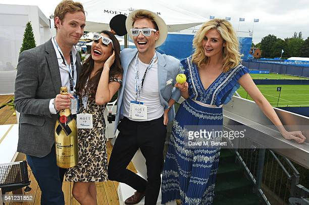 Jack Fox Samantha Barks Ross Witherden and Tamsin Egerton celebrate with Moet Ice Imperial in the Moet Chandon Suite whilst watching the Men's...