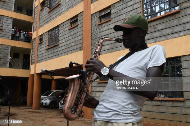 Jack from All Saints Cathedral plays a saxaphone during a sunday school service in an apartment in Kiambu May 24 2020 Jack and joined Reverend Paul...