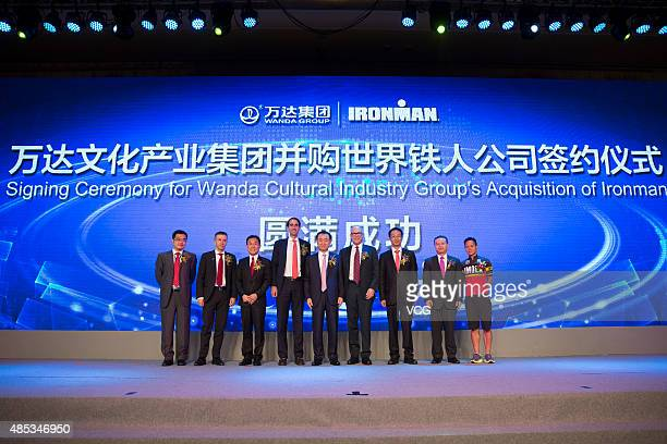 Jack Gao Qunyao vice president of Wanda Cultural Industry Group Andrew Messick chief executive officer of World Triathlon Corporation Davis Noell...