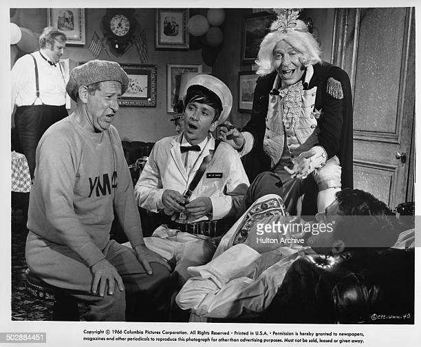 """Jack Gilford, Bob Denver, Milton Berle and Jim Hutton sing in a scene from the Columbia Pictures movie """"Who's Minding the Mint?"""" circa 1967."""